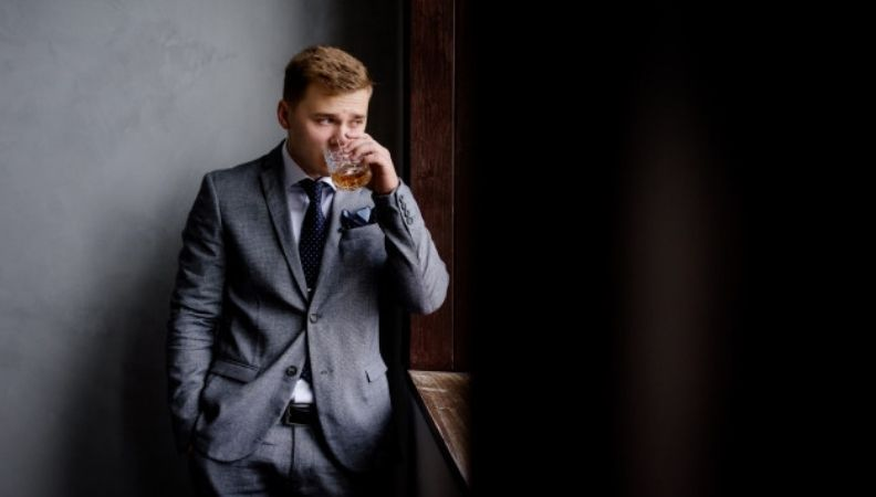 businessman with whisky