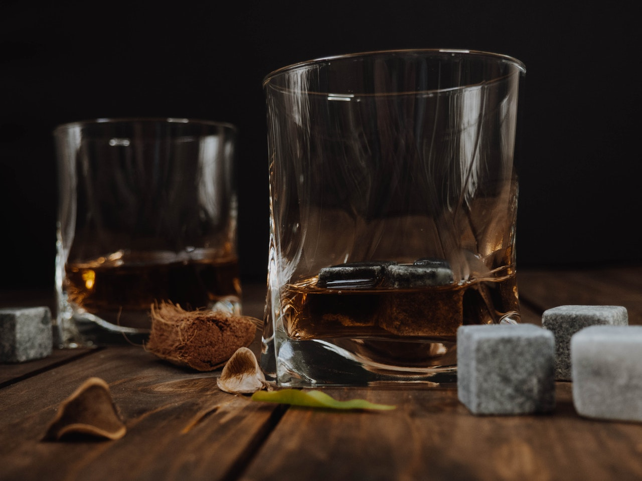 a photo of 2 glasses of Scotch whisky